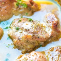 Oven baked honey mustard chicken thighs in a Pyrex baking dish