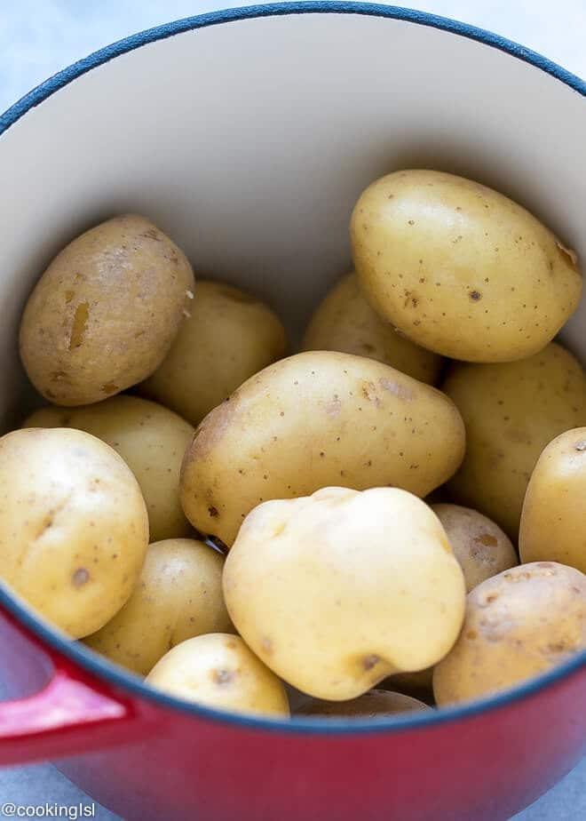 Cheesy Crispy Baked Potato Bites Recipe -A pot filled with Mini Small Yukon Gold Potatoes