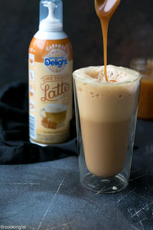 Baked French Toast Sticks Recipe. International Delight One Touch Latte Caramel. Glass filled with latte and caramel drizzle.