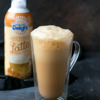 Baked French Toast Sticks Recipe. A clear glass filled with International Delight One Touch Latte in Caramel.
