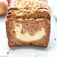 Cream Cheese Filled Apple Bread Recipe -slices of moist apple bread on a cutting board. The perfect slice and apples on the side.