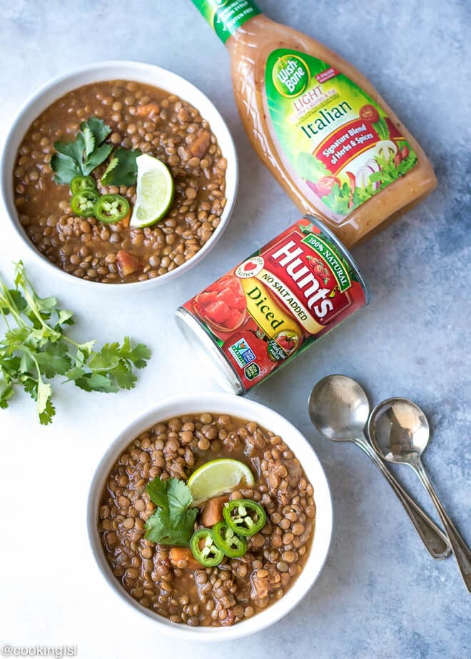 Sweet Potato Lentil Chili Recipe - two bowls with lentil soup and a can of tomatoes on the side. Wish-Bone salad dressing next to it.