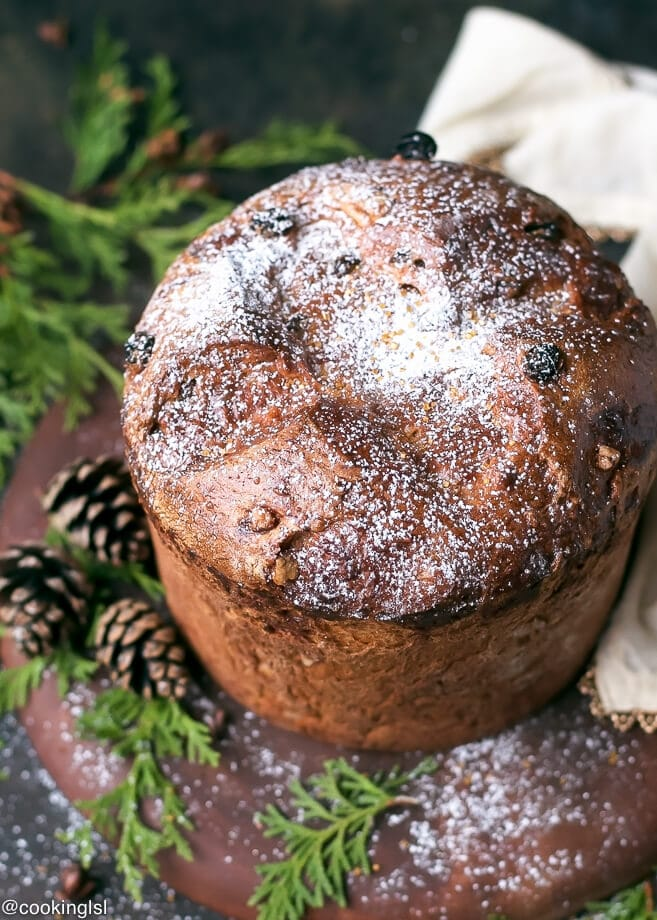 Easy Homemade Italian Christmas Bread Panettone Recipe on a wooden serving board in a holiday setting.