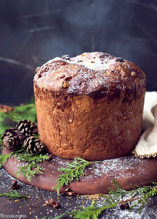 easy homemade italian christmas bread panettone recipe dusted with powdered sugar in a christmas setting
