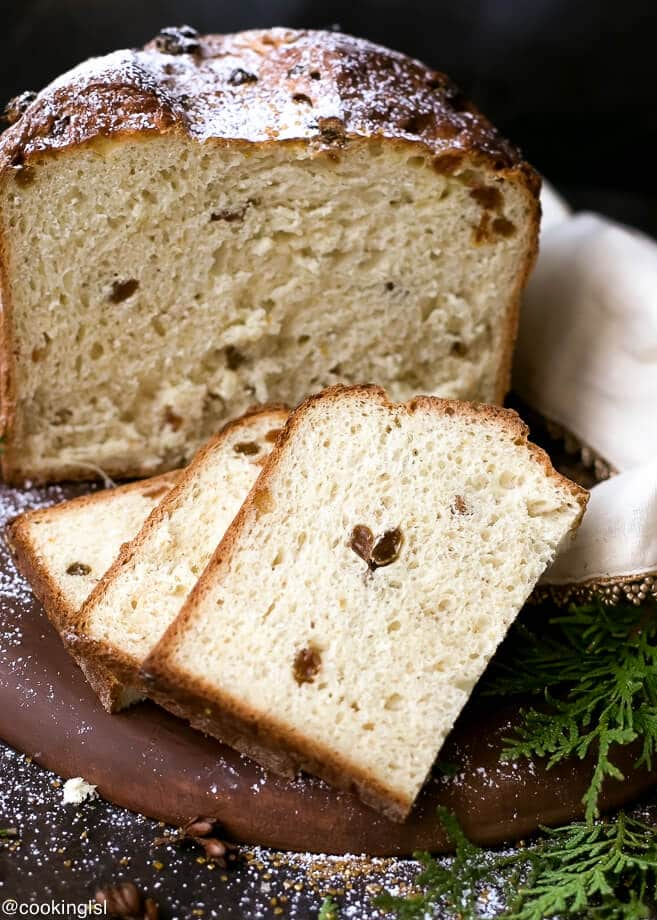 Easy Homemade Italian Christmas Bread Panettone Recipe - slices of soft, moist Panettone, filled with raising and candied orange peel.