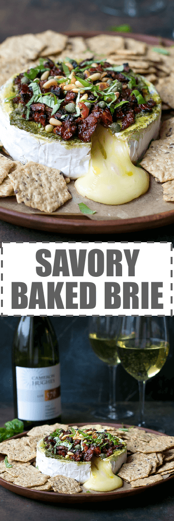 Savory Baked Brie Appetizer With Sun Dried Tomatoes Recipe - the easiest, festive, flavorful and delicious appetizer, perfect for the holidays. Topped with bacon, toasted pine nuts and basil.