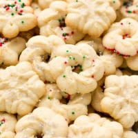 Easy Cream Cheese Spritz Cookies Recipe , made with OXO cookie press, in the shape of wreaths and Christmas trees.