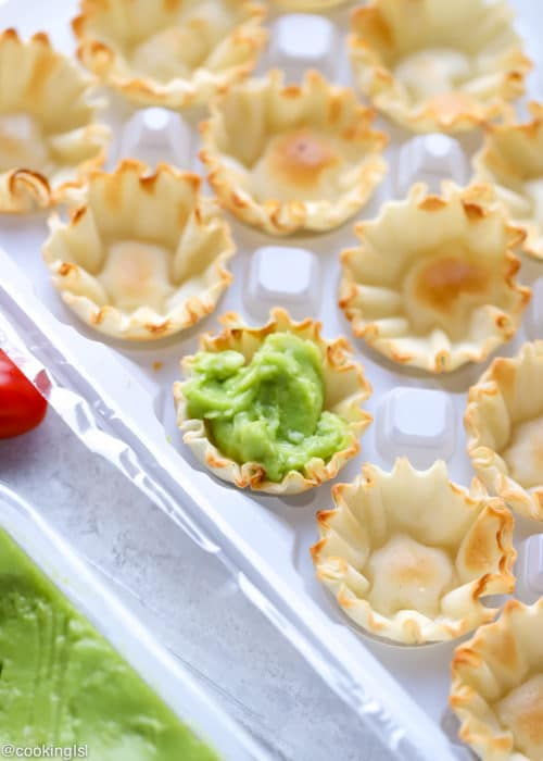 Avocado Filo Cups - Simply Avocado Sea Salt And Garlic Herb Dips, mini fill quiche shells filled with avocado dip