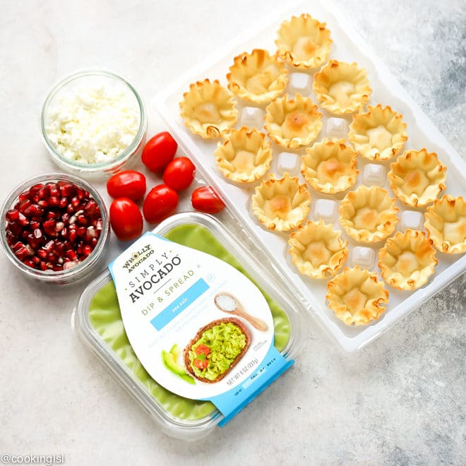 Avocado Filo Cups - Simply avocado dips, chopped tomatoes, phyllo shells, pomegranate seeds and feta