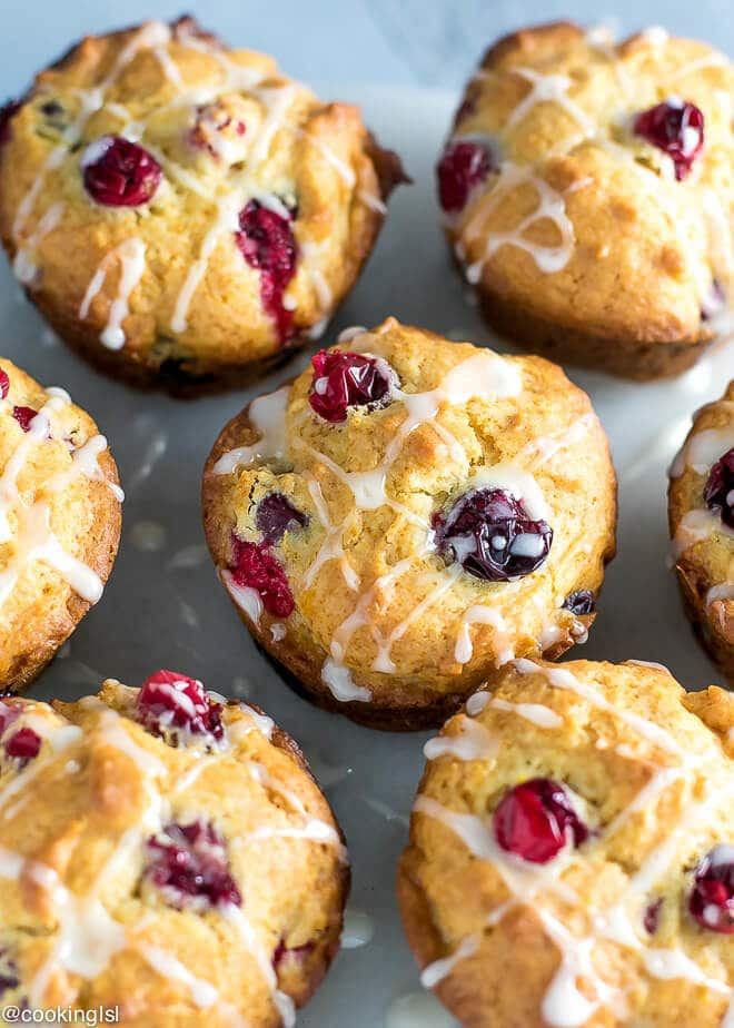 Healthy Cranberry Orange Muffins Recipe Refined Sugar Free on a tray. Made with Greek Yogurt and maple syrup.
