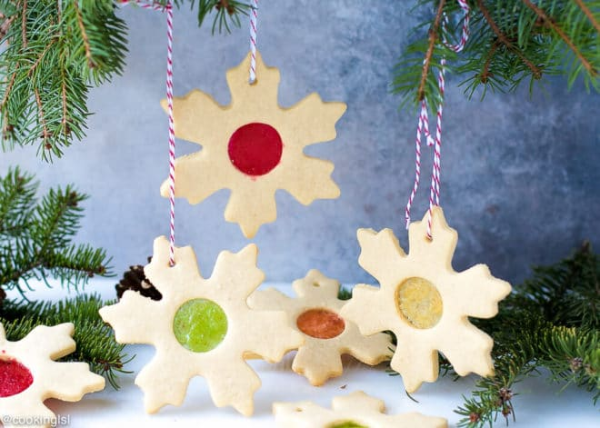 Easy Stained Glass Cookies Recipe- gorgeous cookie stars with candy glass windows in different colors, made with Jolly Ranchers or Lifesavers, hanging on Christmas tree.