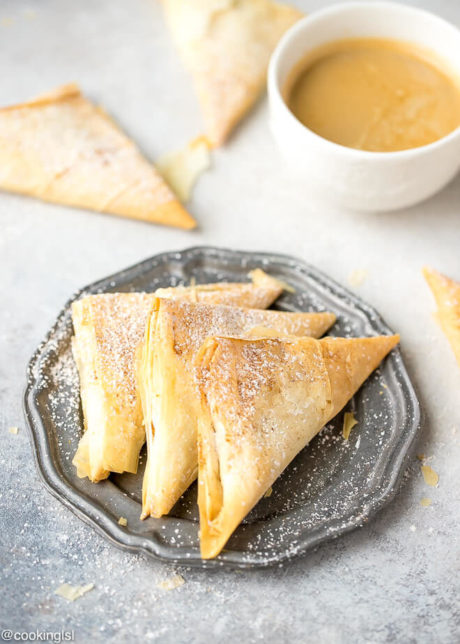 Pumpkin Phyllo Triangles Recipe , on a coffee plate, with a cup of coffee on the side, great for snack or dessert.
