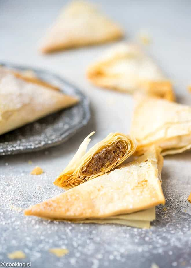 Pumpkin Phyllo Triangles Recipe. Filo pastry triangles cut in half, dusted with powdered sugar and served with coffee.