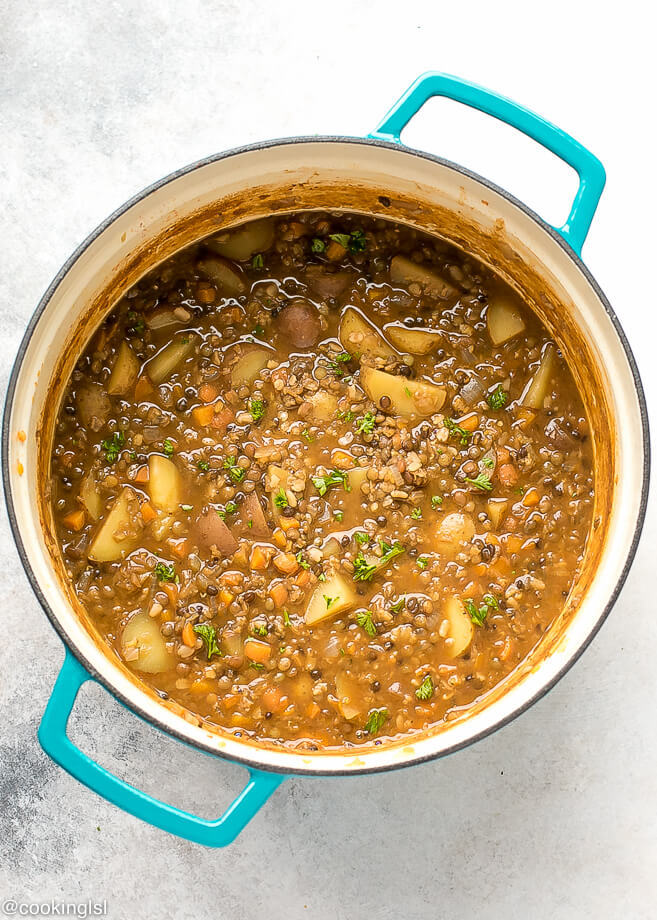 Lentil Potato Soup Recipe. One pot nutritious brown lentil soup in a blue Dutch Oven.