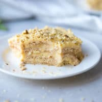 Easy Pudding Graham Cracker Icebox Cake Recipe , topped with chopped walnuts, soft moist layers.