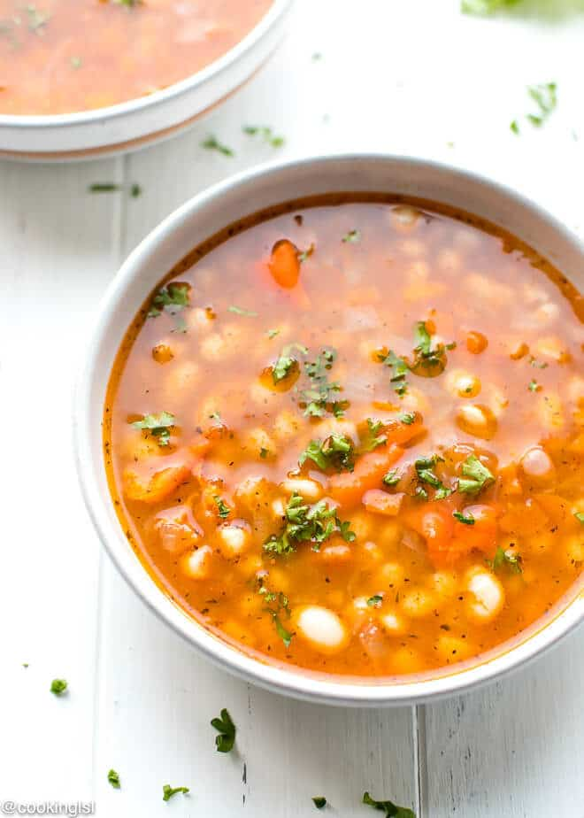 Easy White Bean Soup in a bowl, red peppers, tomatoes, summer savory, mint- Bulgarian National Recipe.
