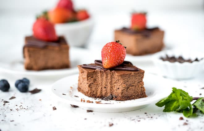 Chocolate Cheesecake Bars Recipe-slices of chocolate cheesecake on white plates
