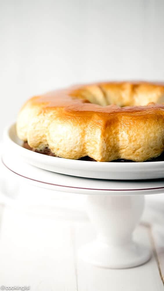 Easy Chocoflan Recipe - Kodrit Kadir - Bulgarian dessert made in a bundt pan. Placed on a white cake pedestal.