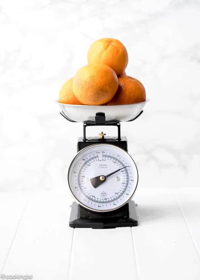 Easy Blood Orange Bundt Cake Recipe- blood oranges on a vintage kitchen scale for food photography. Food photography scale.