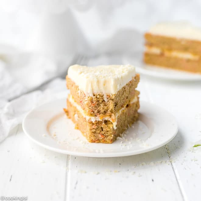 Low Carb Keto Carrot Cake Recipe on a white plate, a bite taken into it