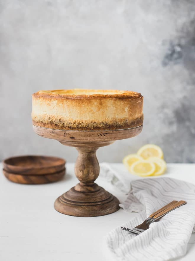 Keto cheesecake recipe - on a cake stand with lemons