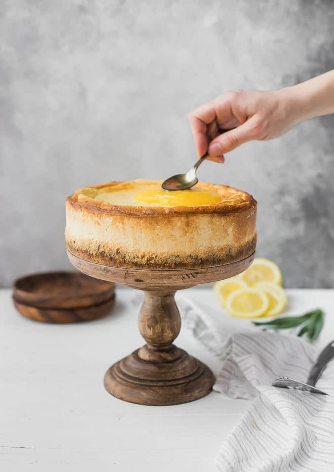 keto Cheesecake Recipe - cake on a wooden pedestal