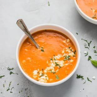Tomato feta soup in a white bowl