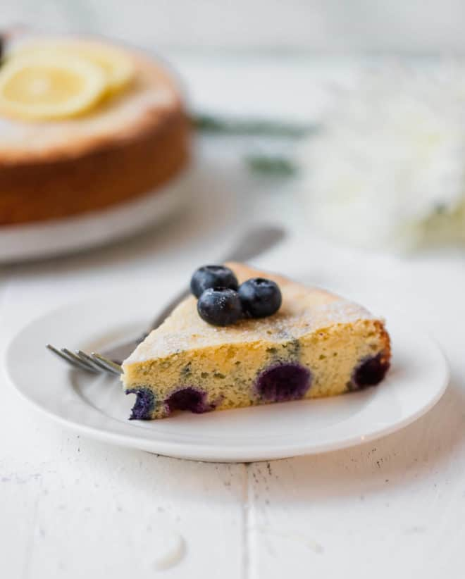 A slice of Keto Lemon Cake With Blueberries {Low-Carb, Gluten-Free}