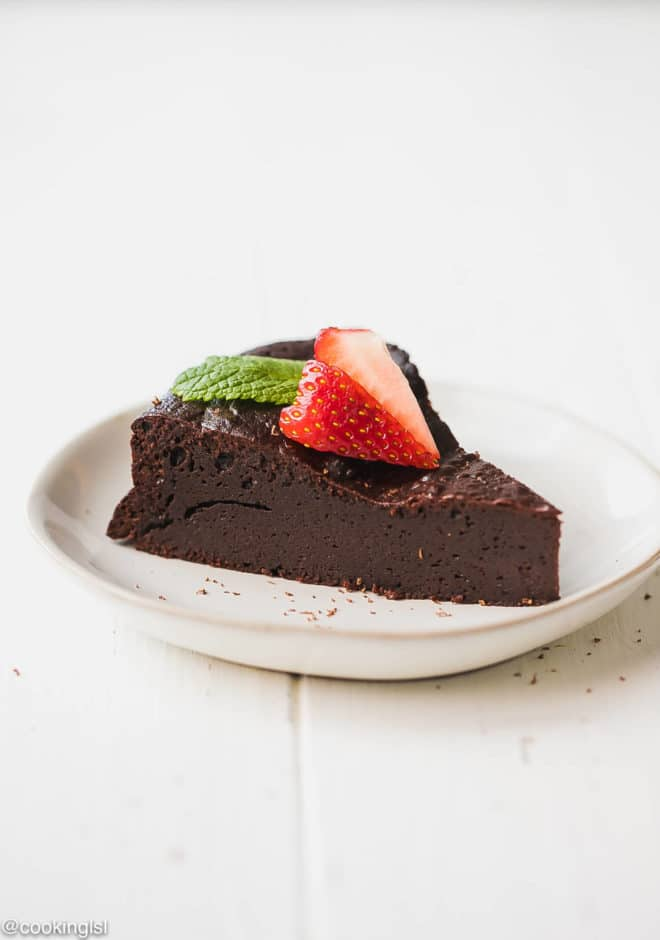 Keto Flourless Chocolate Torte topped with strawberry on a plate