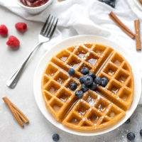 Crispy Belgian Waffles Recipe on a plate topped with blueberrier