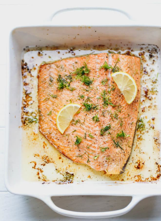 Lemon Baked Salmon Recipe topped with lemon and chopped dill