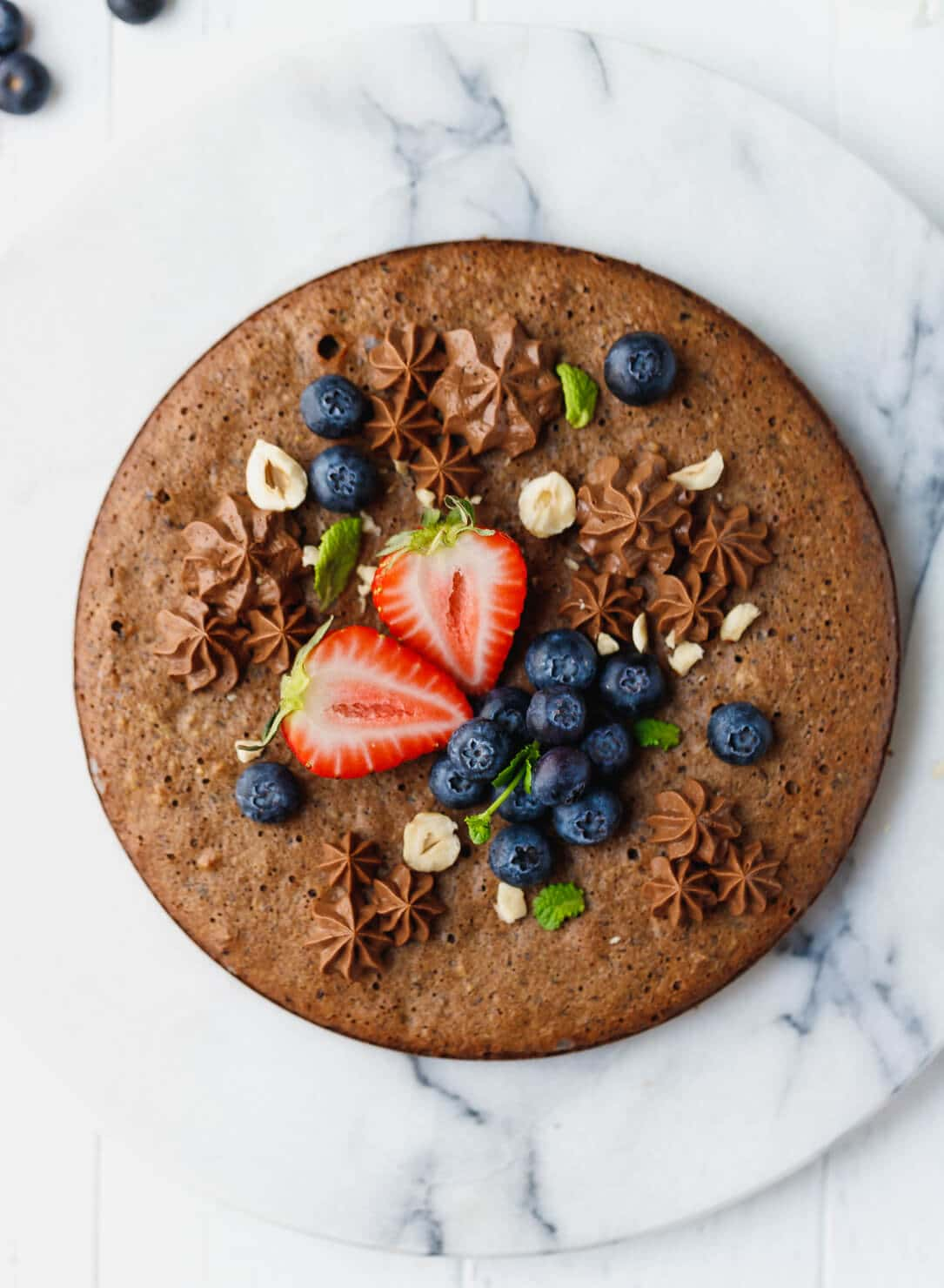 Sugar-Free, Low-Carb Chocolate Hazelnut Cake recipe that makes a soft and nutty, chocolatey cake that tastes amazing and requires just four simple ingredients.