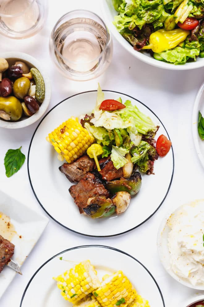 Beef kebabs on a plate with salad