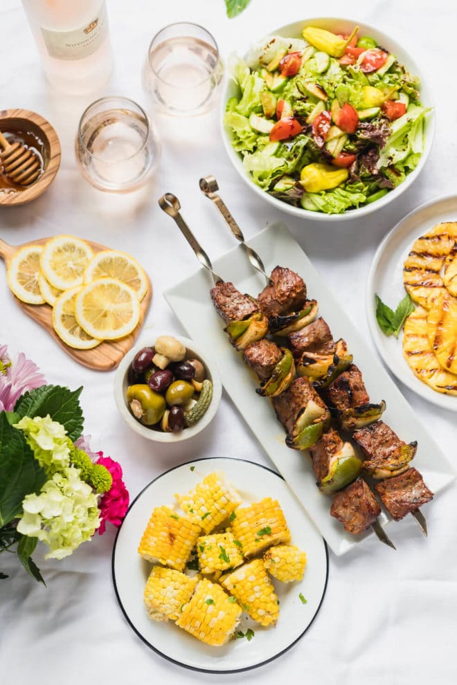 Grilled pineapple recipe and Father's Day meal on a table with white tablecloth