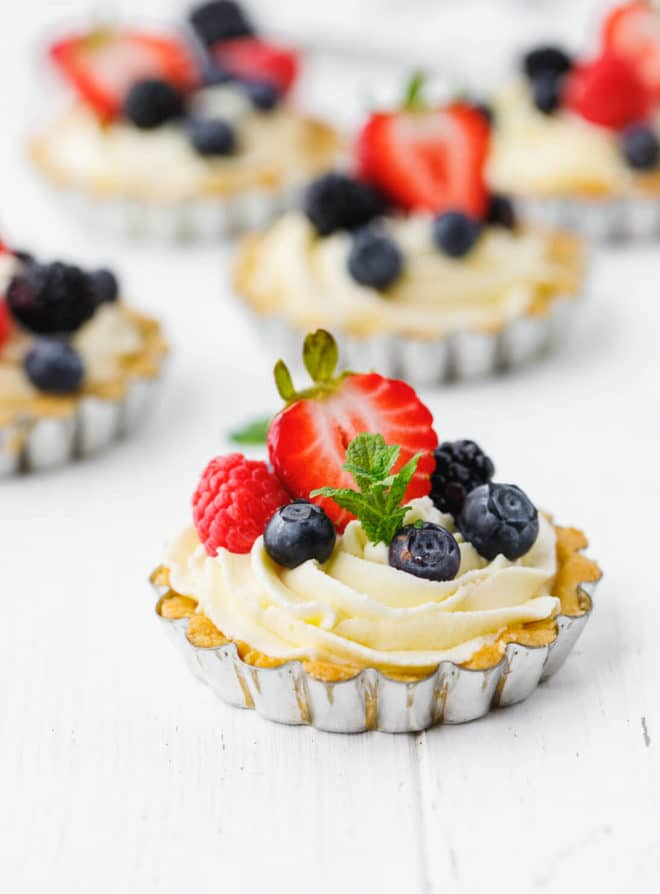 Low-Carb, Keto Tarts With Berries And Mascarpone Cream in a tart tin