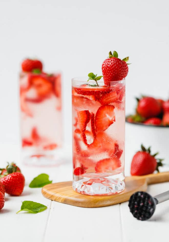 Sugar-Free Strawberry Smash Cocktail in tall clear glasses