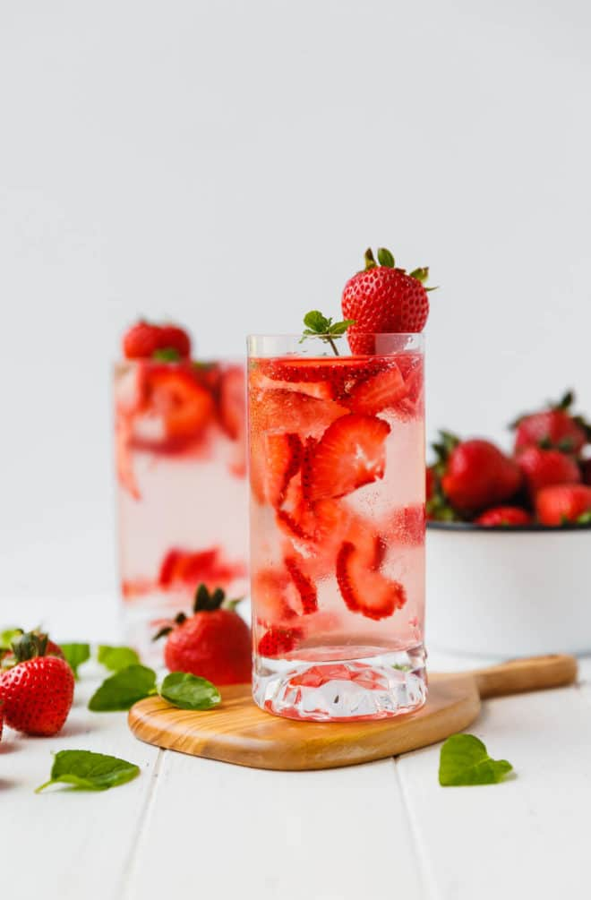 Sugar-Free Strawberry Smash Cocktail in a tall clear glass topped with strawberry