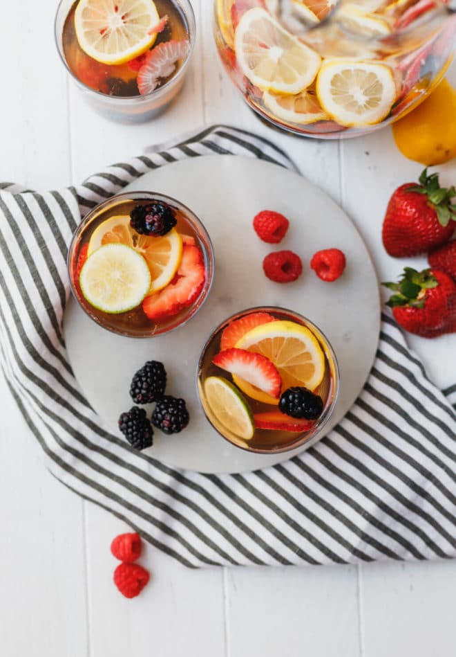 White Wine Berry Sangria Recipe in clear glasses and a pitcher