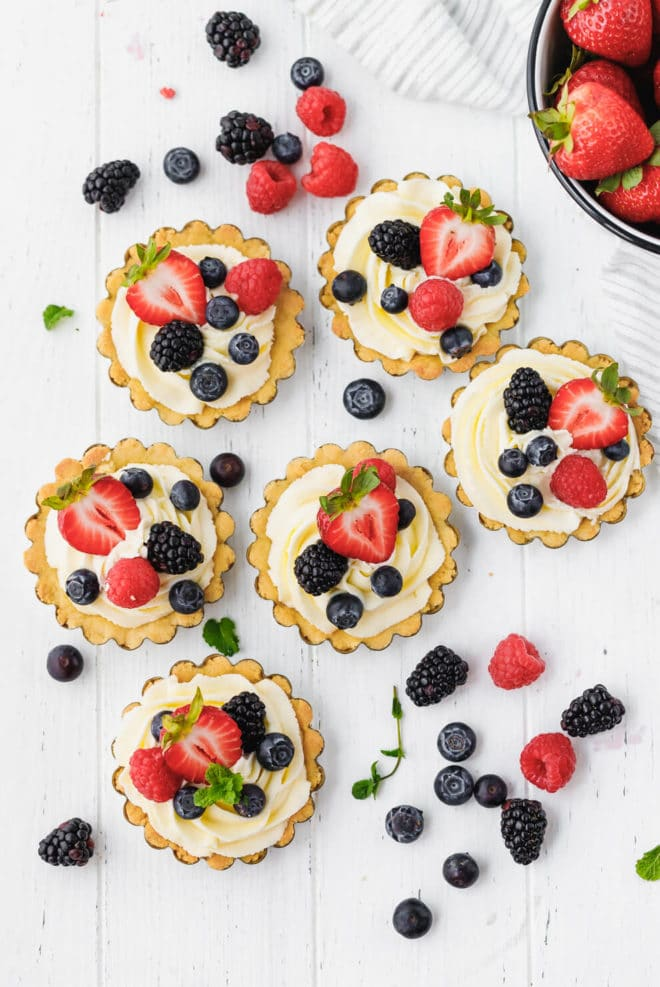 Low-Carb, Keto Tarts With Berries And Mascarpone Cream on a white table