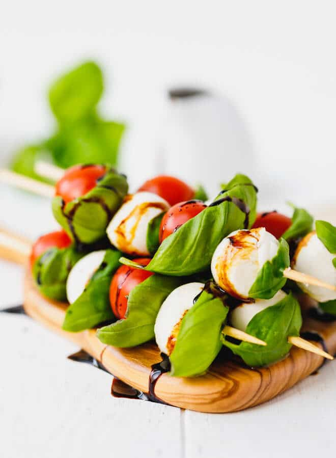 Caprese Skewers With Balsamic on a wooden board