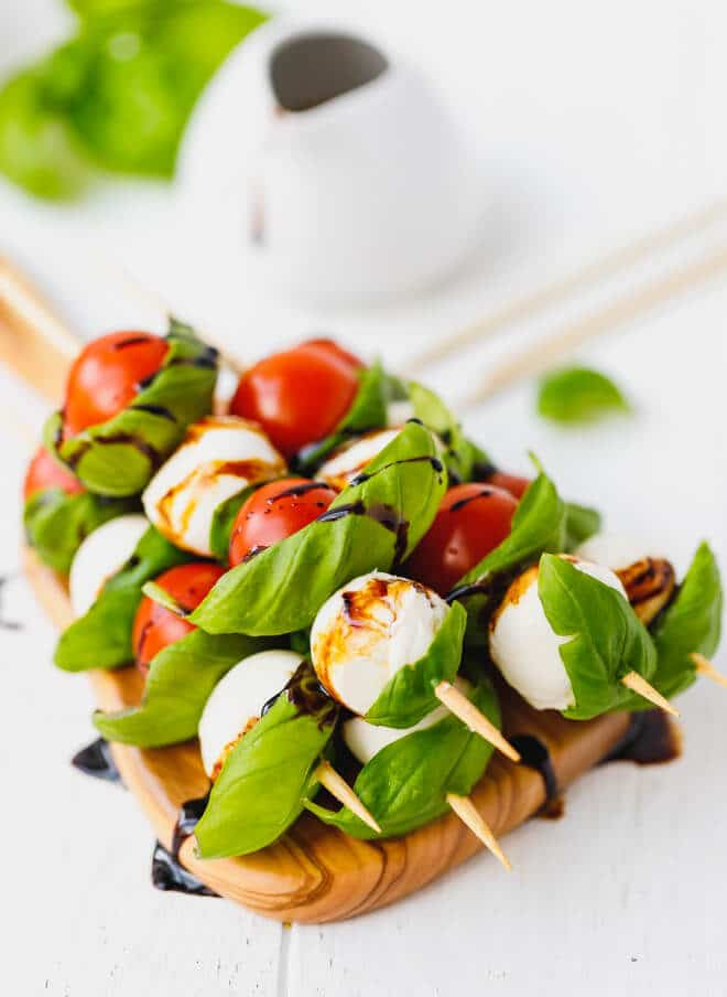 Caprese Skewers With Balsamic on a board