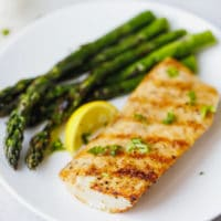 Grilled Mahi Mahi Recipe on a white plate with asparagus on the side