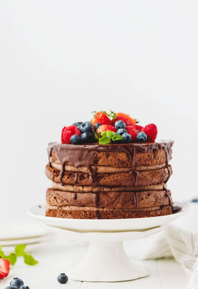 A small 6-inch naked Keto chocolate cake on a cake stand