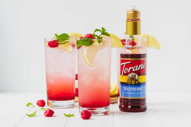 Sparkling raspberry lemonade in tall clear glasses