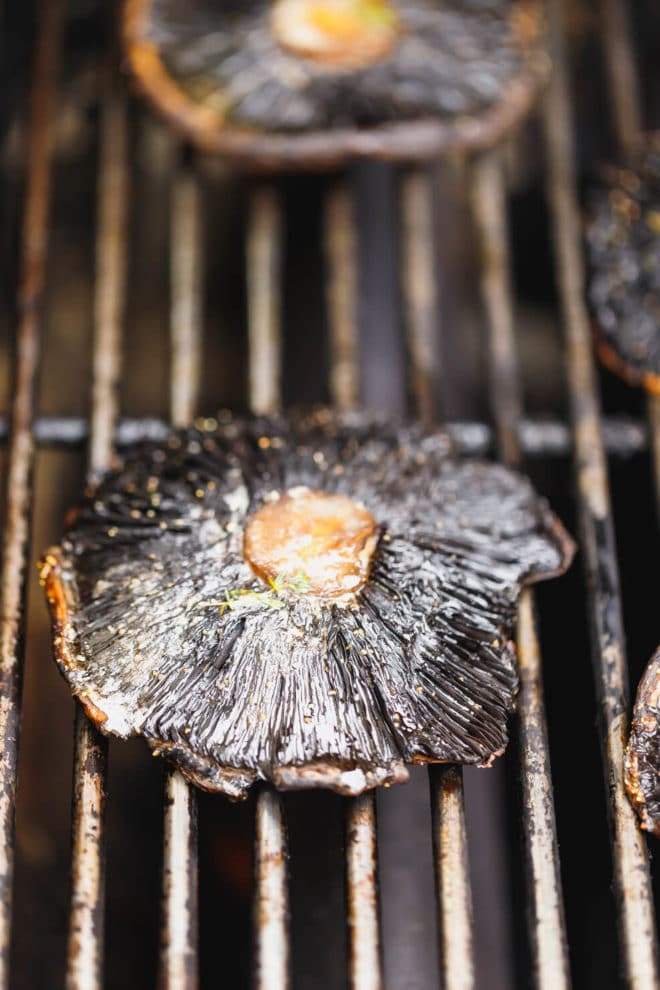 Grilled portobello mushrooms on a grill