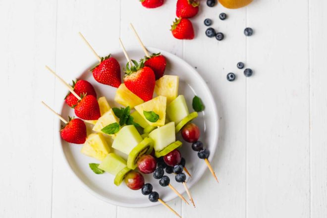 Fruit skewers on a white plate