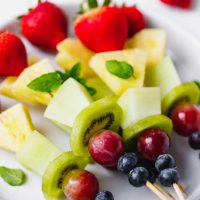 fruit skewers on a plate
