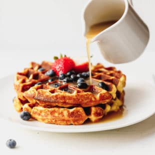 Keto waffles on a plate with Sugar-free Syrup and berries