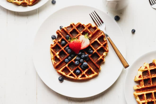Low-carb waffle on a plate with berries
