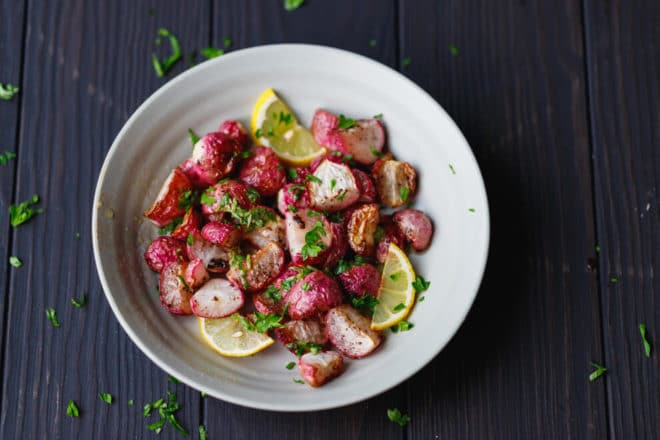 Colorful roasted radishes in a bowl